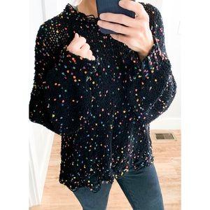 cozy black confetti distressed hem knit sweater